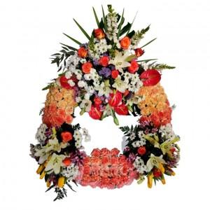 Gran corona tres cabezales(Floristerias Monica)
